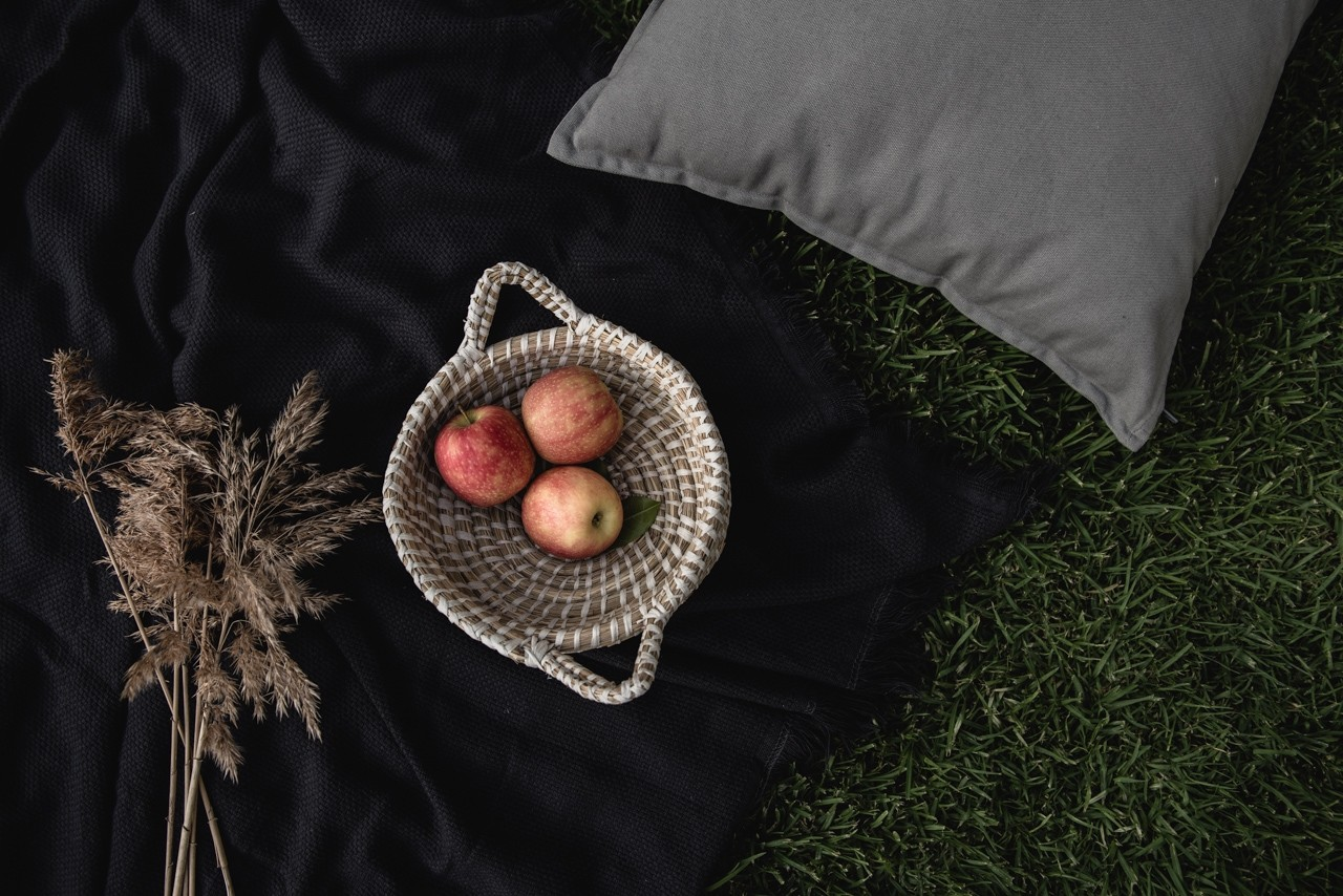 Apples in a basket on a picnic